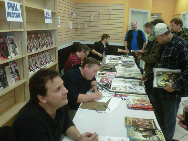 Signing at Westfield East Grand Opening. Front to back: Steve Bryant, Phil Hester, Bill Reinhold, Linda Lessman, and Matthew Waite.