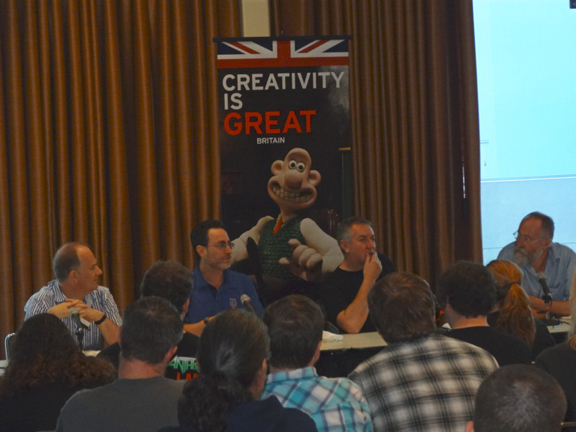 The British Invasion panel with Mark Buckingham, moderator Robert Greenberger, Barry Kitson, and Brian Bolland.