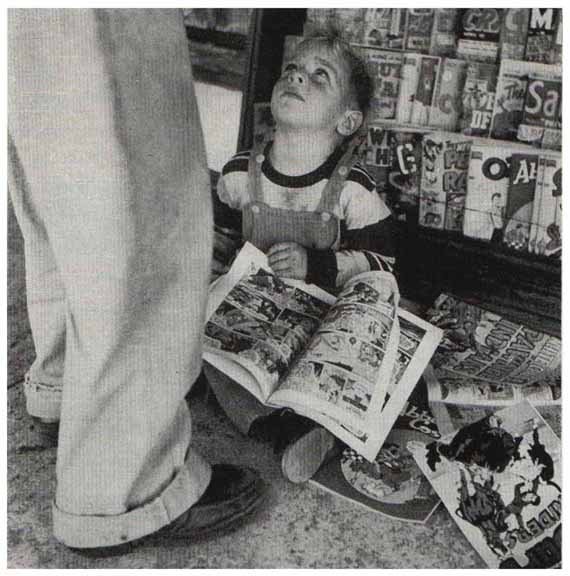 Not KC reading comics, but a photo from an old Friends magazine.